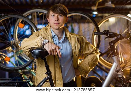 Portrait Of A Handsome Man With Bicycles Behind