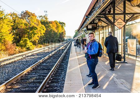 Burke, Usa - October 27, 2017: Young Man Waiting On Platform For Vre Train To Washington Dc For Comm