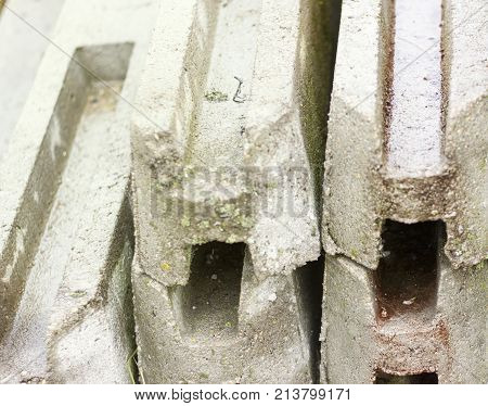 Reinforced concrete structures reinforced concrete piles for fencing. close-up