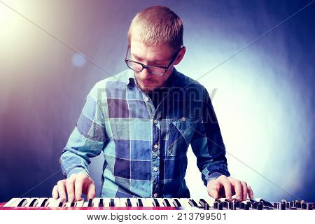 Artist Playing On The Keyboard Synthesizer Piano Keys. Male Musician Plays A Musical Instrument