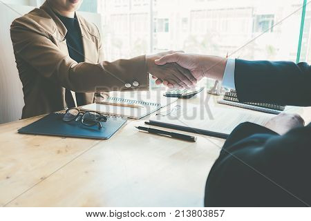 Business Handshake And Business People.vintage Tone Retro Filter Effect Soft Focus Low Light.
