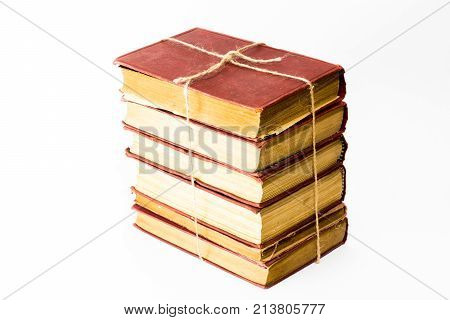 The pile of books on the white background. The books are isolated on white and a clipping path is provided for easy extraction.