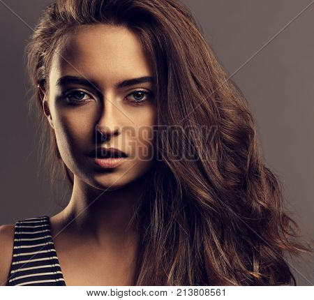 Beautiful Calm Woman With Nude Day Makeup And Effect Eye Brows, Curly Volume Hair Style Looking Myst