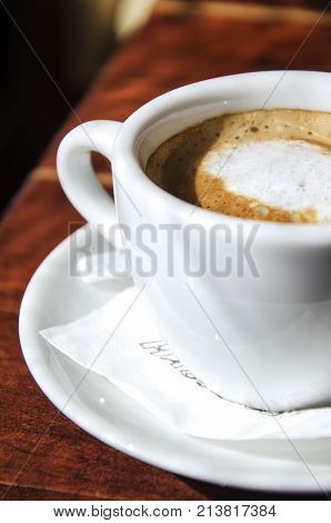 white cup of coffee close up . caffeine drink