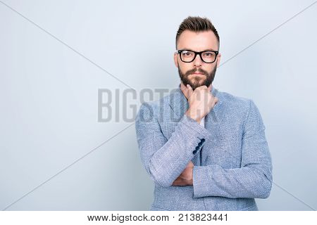 Successful Young Brutal Bearded Brunet Banker In Formal Wear And Black Trendy Glasses Is Standing Is