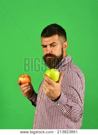 Man With Beard Holds Red And Green Apples