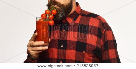 Guy Holds Homegrown Harvest. Man With Beard Drinks Tomato Juice