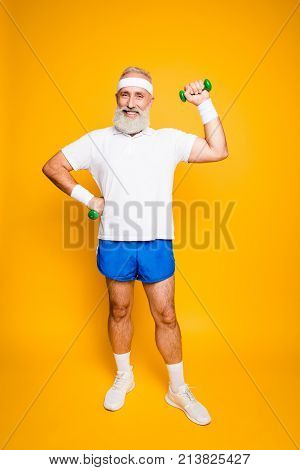 Full Length Of Cheerful Emotional Cool Grandpa With Humor Grimace Exercising Holding Equipment, Lift