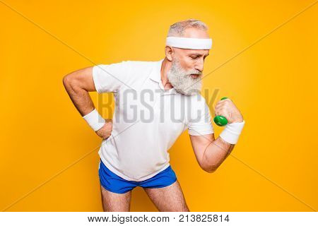 Body Care, Hobby, Weight Loss Lifestyle. Cool Grandpa With Confident Grimace Exercising Holding Equi