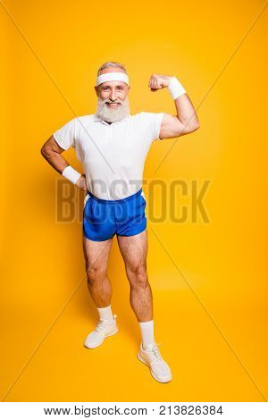 Full Length Of Cheerful Excited Mature Goofy Cool Pensioner Grandpa Champion Practising Bodybuilding