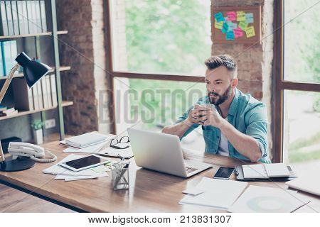 Virile Stylish Ponder Freelance Worker In Casual Smart, Concentrated, Focused, Serious, Sitting At T