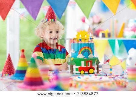 Kids Birthday Party. Child Blowing Out Cake Candle