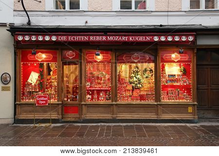 SALZBURG, AUSTRIA - JANUARY 5, 2013: The facade of house with showcase of Mozartkugeln candy shop in Salzburg, Austria. The world's largest producer of famous Mozartkugeln is the German company Reber Specialities.
