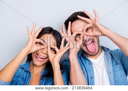 Concept Of Having Funtime And Grimacing, Behaving Like Kids. Close Up Photo Of Two Happy People Maki