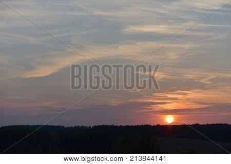 Evening sun over the forest Sahaja, beautiful evening sunset, a beautiful evening sky
