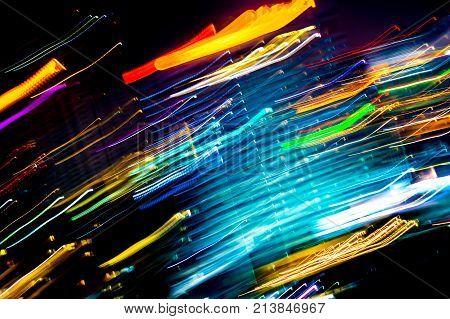 Beautiful lighting of Night futuristic line LED building abstract Shooting style light color blur in Swirled night lights busy city abstract background. Movement of origin of multi colored lights.