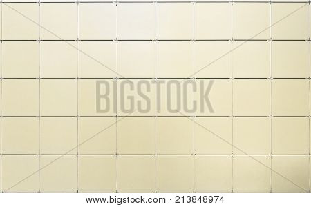 Yellow tiles wall texture. Yellow tiles wall texture. Tiled wall background
