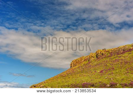 Isle of Skye Scotland - August 12 2017: Tourists relax on the Coral Beach in the Isle of Skye.