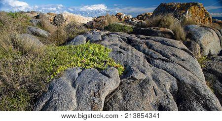 Rock Formations Against Grey Sky At Grey Rocks Beach Near Moruya On The Nsw South Coast In Australia