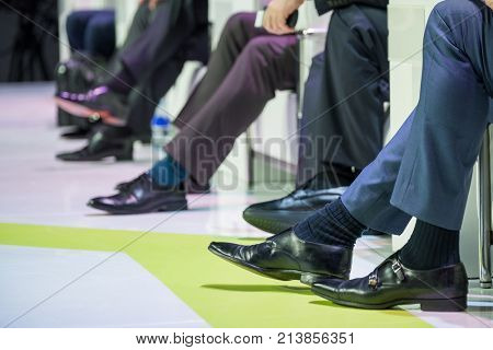 Speakers shoes at the business conference