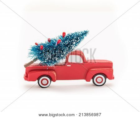 Christmas Tree On Toy Pickup Truck. Christmas Holiday Celebration Concept