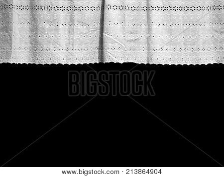 White lvintage ace curtain with small flower pattern window isolated on black background