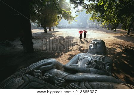 The forgotten buddha Buddha statue laying on the ground Mandalay Myanmar