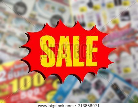 word SALE on red speech bubble over blurred catalogue background. Online shopping or e-commerce concept.