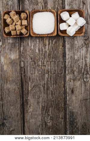 Three Bowls Of Sugar  On A Wooden Background