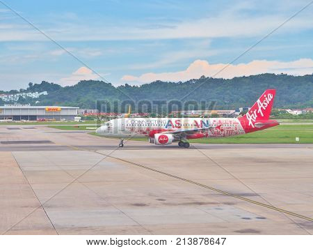 Penang, Malaysia - May 13, 2017: An Air Asia Airbus preparing for take-off from Penang International airport in Penang Island, Malaysia. Air Asia is a low-cost airline from Malaysia.
