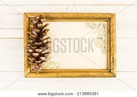 Blank Greeting Card In Photo Frame With Pine Cone