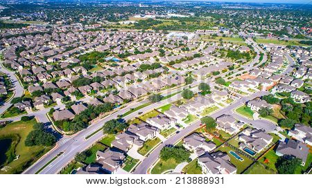 Modern Suburbia With Lots Of Concrete And Homes In Bright Sunshine. Huge Massive Suburb Neighborhood