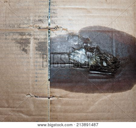 Brown Corrugated Cardboard Texture Background With Motor Oil Stain
