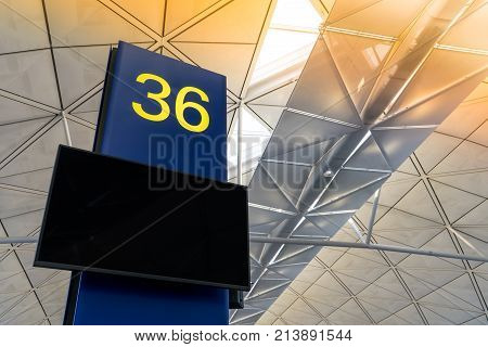 Sunlight at airport terminal with blank terminal screen display for passenger or traveler. Morning for travel at airport terminal.