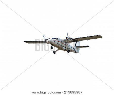 Flying small passenger propeller plane  isolated on white background