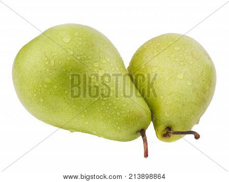 Two green, ripe and juicy pears in drops of water close-up on a white isolated background