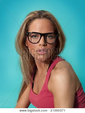 Beautiful Girl on Blue Background Wearing Eyeglasses