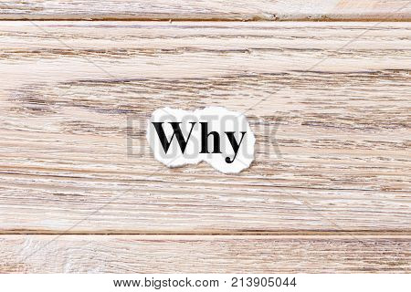 Why of the word on paper. concept. Words of Why on a wooden background.