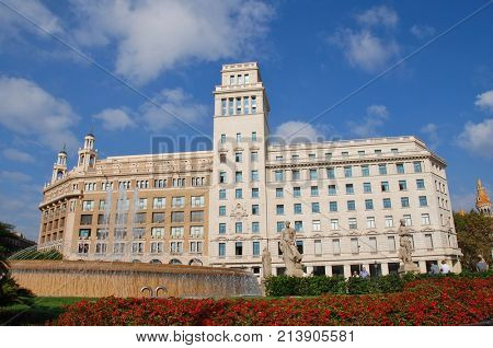 BARCELONA, SPAIN - NOVEMBER 1, 2017: The historic Placa de Catalunya which is a public hub for the City. The flagship store of casual clothing brand Desigual is in the background.