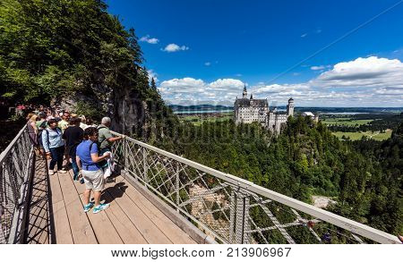 Neuschwanstein Castle, Germany - June 30, 2017: Viewing point on the bridge Neuschwanstein Castle The castle was intended as a home for the king, until he died in 1886.
