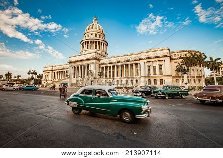 HAVANA, CUBA - JUNE 7, 2011: Old classic American car rides in front of the Capitol Havana. Before a new law issued on October 2011, cubans could only trade cars that were on the road before 1959.