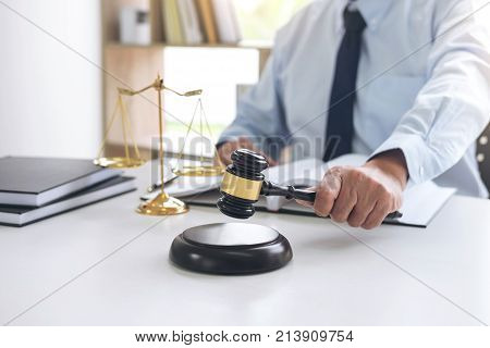 Judge gavel with scales of justice male lawyers working having at law firm in office. Concepts of law. poster