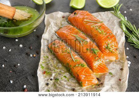 Marinated slices of salmon fillet on table