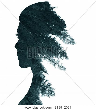 Double exposure of woman's silhouette in profile and forest. Isolated on white.