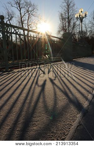 Park Bridge Road With Guardrail Sun Lights Shadow.