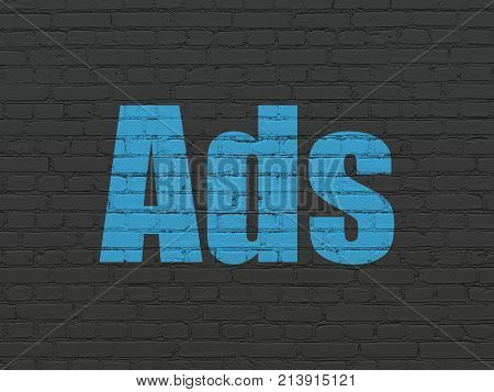 Advertising concept: Painted blue text Ads on Black Brick wall background
