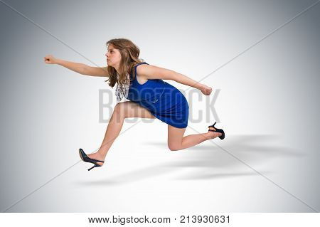 Small business woman running away from a boss pressure - boss pressure concept