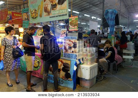 People Buy Foods In The Night Market