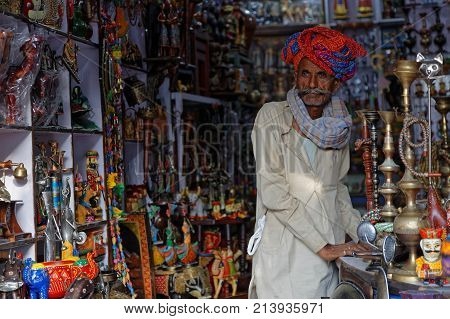 Pushkar, India, October 29, 2017 : A Man In His Store. Pushkar Camel Fair Is One Of The Largest Catt