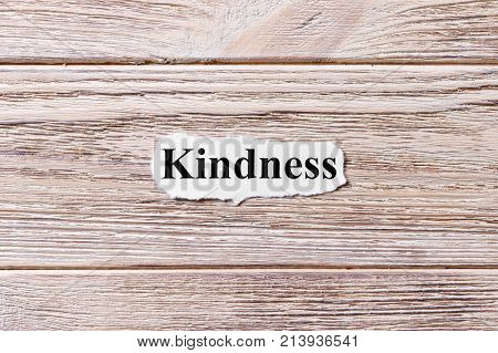 kindness of the word on paper. concept. Words of kindness on a wooden background.